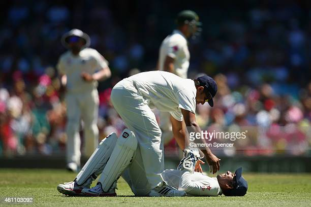Wriddhiman Saha of India is congratulated after catching out Shaun Marsh of Australia off the delivery of Mohammed Shami during day two of the Fourth...