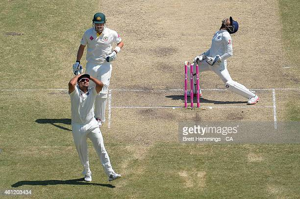 Wriddhiman Saha of India reacts after a missed run out opportunity on Shane Watson during day four of the Fourth Test match between Australia and...