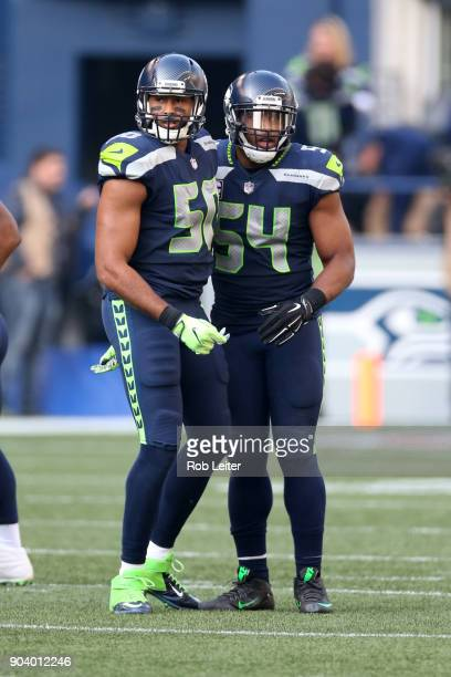 J Wright and Bobby Wagner of the Seattle Seahawks look on during the game against the Houston Texans at CenturyLink Field on October 29 2017 in...