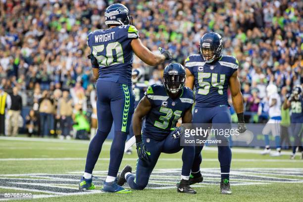 J Wright Kam Chancellor and Bobby Wagner of the Seattle Seahawks celebrate a defensive stop during a game between the Seattle Seahawks and the...