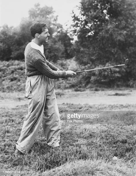Wright of Great Britain hits out of the rough approaching the 15th green during The Daily Telegraph and Morning Post national golf tournament on 4th...