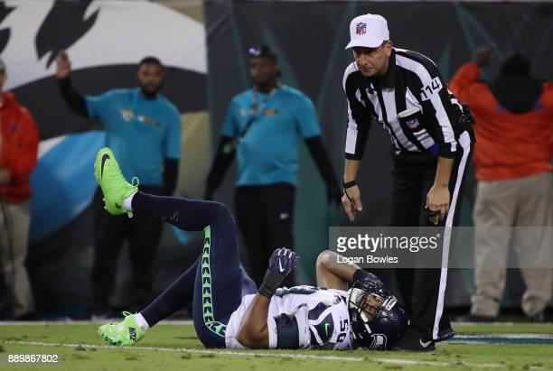 J Wright of the Seattle Seahawks lays on the field after an injury during the second half of their game against the Jacksonville Jaguars at EverBank...