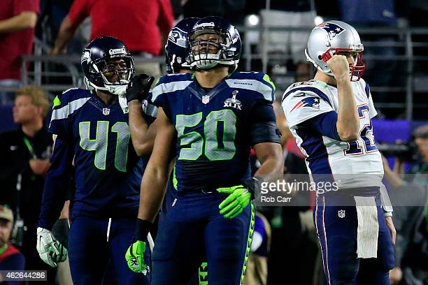 J Wright of the Seattle Seahawks reacts after a touchdown pass in the fourth quarter by Tom Brady of the New England Patriots during Super Bowl XLIX...