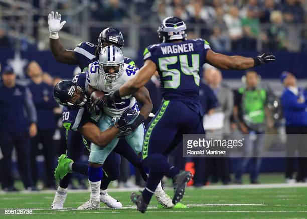 J Wright of the Seattle Seahawks tackles Rod Smith of the Dallas Cowboys in the second quarter of a football game at ATT Stadium on December 24 2017...