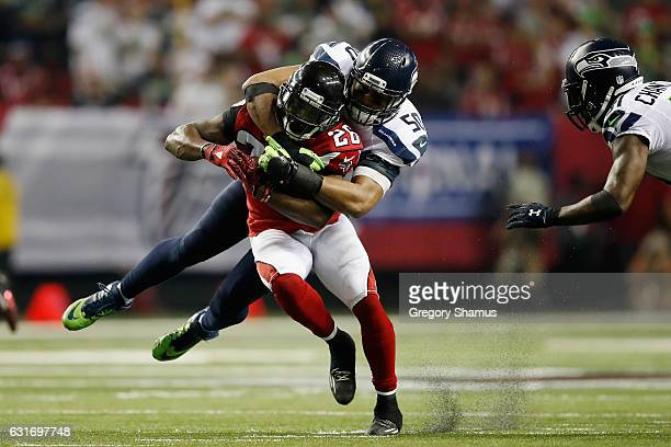 J Wright of the Seattle Seahawks tackles Tevin Coleman of the Atlanta Falcons at the Georgia Dome on January 14 2017 in Atlanta Georgia