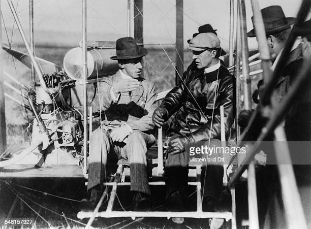 Wright Orville and Wilbur Pioneers of aviation inventors of the first engine powered aircraft USA with King Alfonso XIII of Spain 1909 Photographer...