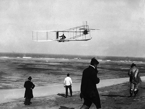 American aviator and inventor Orville Wright flies...