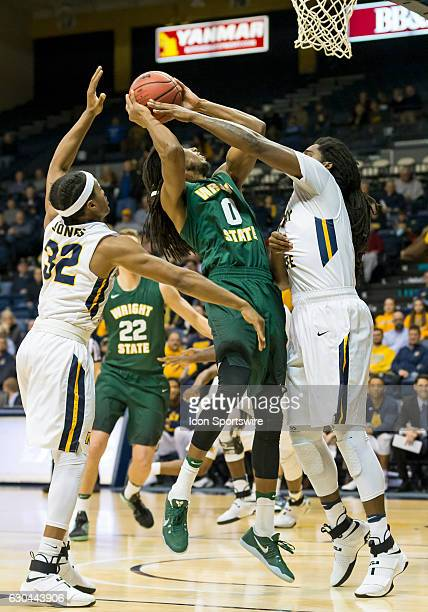 Wright State forward Steven Davis tries to put up a shot between two Murray State defenders during an NCAA basketball game between the Murray State...