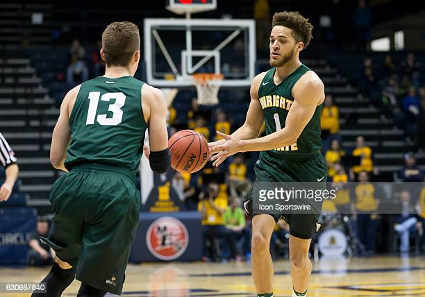 Wright State guard Justin Mitchell hands off the ball to Wright State guard Grant Benzinger during an NCAA basketball game between the Murray State...