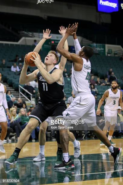 Wright State Raiders center Loudon Love looks to shoot as Cleveland State Vikings Stefan Kenic and Cleveland State Vikings Kenny Carpenter defend...