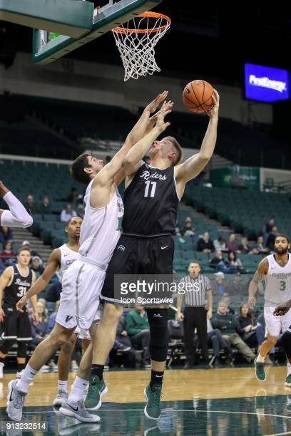 Wright State Raiders center Loudon Love shoots as Cleveland State Vikings Stefan Kenic defends during the first half of the men's college basketball...