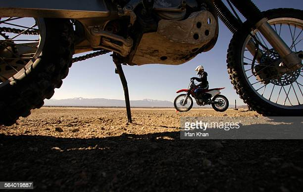 Wrightwood Mar02 2006 – – – Tracy Immken practices dirt biking at El–Mirage Off–Highway Vehicle Recreation Area located in the Mojave Desert on the...