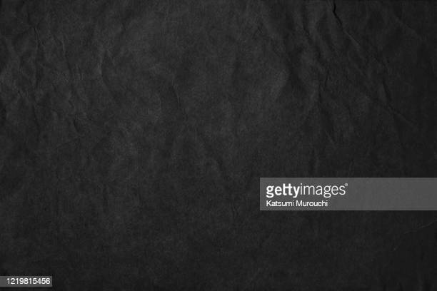 wrinkled black craft paper texture background - black colour stock pictures, royalty-free photos & images