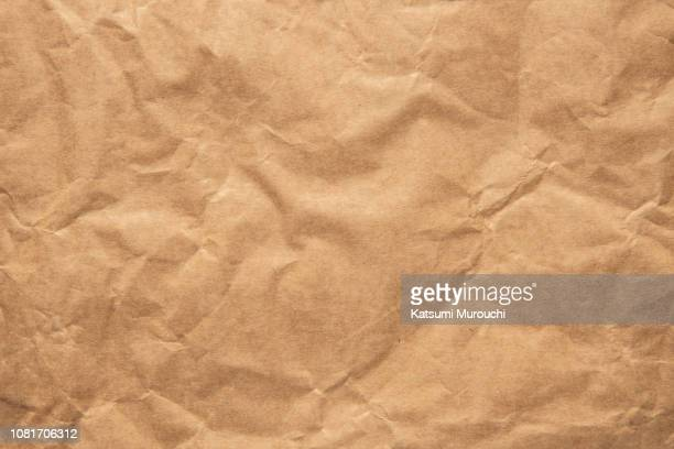 wrinkled brown paper texture background - brown paper stock pictures, royalty-free photos & images