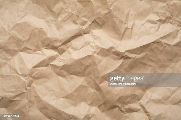 Wrinkled brown paper texture background