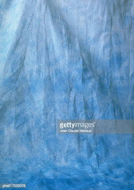 Wrinkled, light-blue patterned fabric, full frame