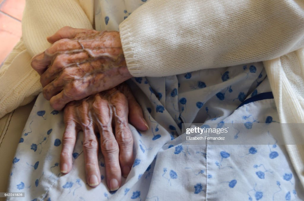 Wrinkled old hands : Stock Photo