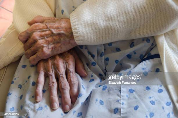 wrinkled old hands - dementia stock pictures, royalty-free photos & images
