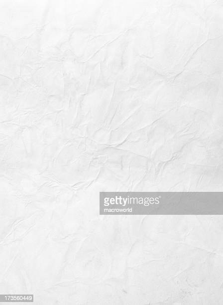 Wrinkled piece of paper against a white background