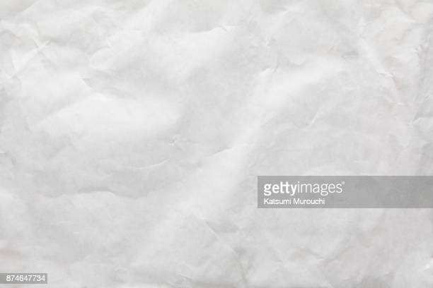 Wrinkled white paper texture background