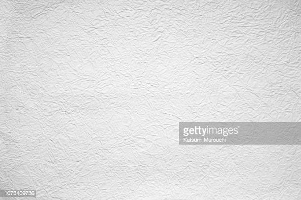 Wrinkled white washi paper texture background