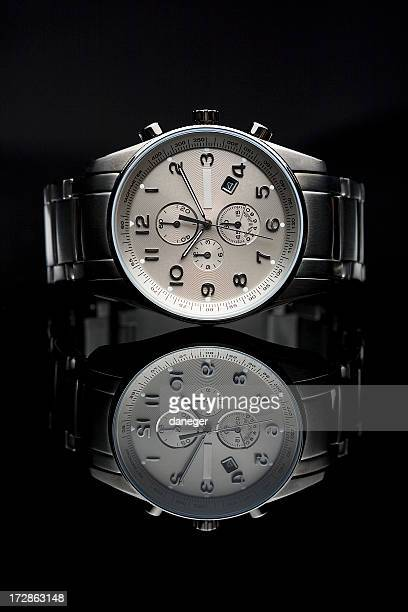 Wrist watch lying, beautiful reflection