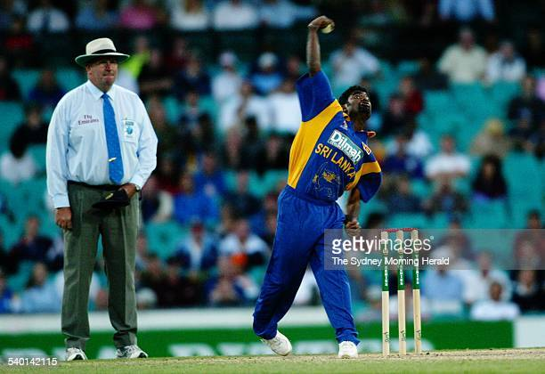Sri Lankan spinner Muttiah Muralitharan bowls under the watchful eyes of umpire Darrell Hair at the SCG yesterday DIGICAM 000000 cricket 130103 Tim...
