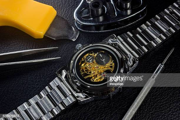 wristwatch and repair tools - lifeispixels stock pictures, royalty-free photos & images