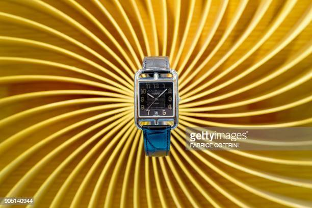 A wristwatch manufactured in Switzerland by La Montre Hermes a subsidiary of the Hermes French luxury brand is displayed in a showcase on the opening...