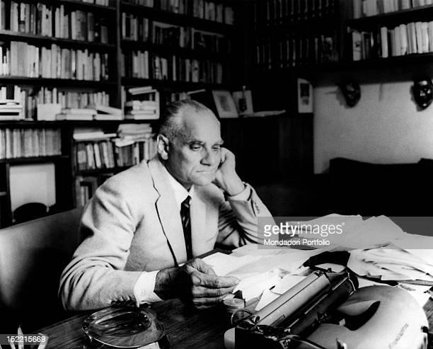 Writer Alberto Moravia in the office of his Roman house near Piazza del Popolo Rome 1962