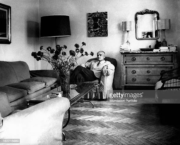 Writer Alberto Moravia sits in an armchair in his Roman house near Piazza del Popolo Rome 1962