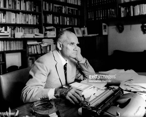 Writer Alberto Moravia thoughtful is seated in the office of his Roman house near Piazza del Popolo Rome 1962