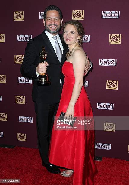 Writer Alexander Dinelaris and guest attend the 21st Century Fox and Fox Searchlight Oscar Party at BOA Steakhouse on February 22 2015 in West...