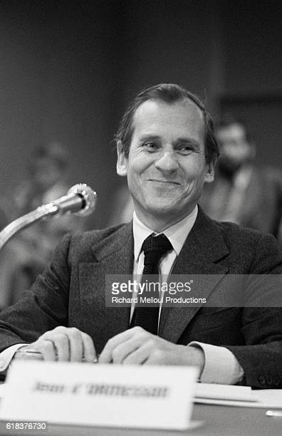 Writer and Academie Francaise member Jean d'Ormesson smiles as he sits at the microphone at the Europe 1 radio station d'Ormesson took part in the...