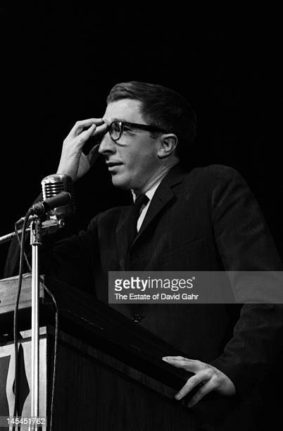 Writer and critic John Updike on stage in November 1966 at an event for Russian poet Yevgeny Yevtushenko at Queens College in New York City New York