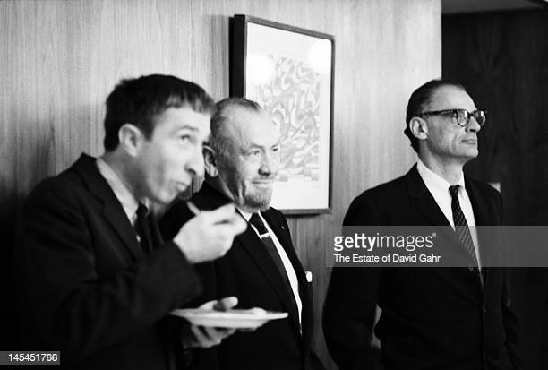Writer and critic John Updike writer John Steinbeck and playwright and essayist Arthur Miller attend an event for Russian poet Yevgeny Yevtushenko in...
