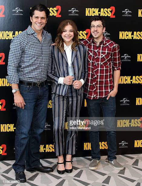 Writer and director Jeff Wadlow Actors Chloe Grace Moretz and Christopher MintzPlasse attend the KickAss 2 photocall on August 5 2013 in London...