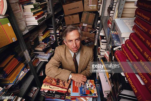 Writer and documentary filmmaker Roger Graef poses in Waterstones bookshop in Notting Hill in London England on December 18 1991