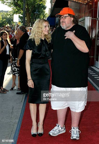 """Writer and executive producer Madonna stands with filmmaker Michael Moore at The State Theater for a screening of the new film, """"I Am Because We Are""""..."""