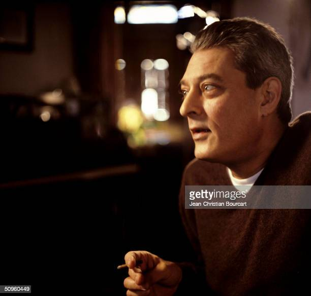 Writer and film maker Paul Auster poses in his Brooklyn apartment on March 13 2002 in New York City