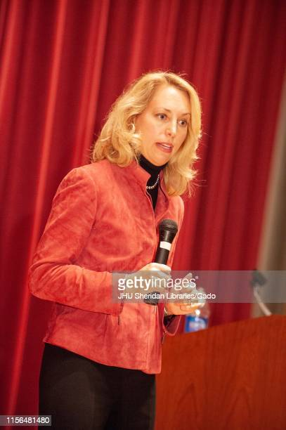 Writer and former Central Intelligence Agent Valerie Plame holding a microphone while speaking at a Milton S Eisenhower Symposium at the Johns...