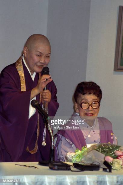 Writer and monk Jakucho Setouchi talks at the opening of the exhibition of writer Chiyo Uno at Takashimaya Department Store on April 2 1992 in Tokyo...