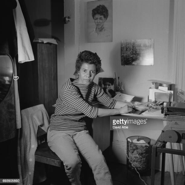 Writer and playwright Lorraine Hansberry poses for a portrait in her apartment in 1959 in New York City New York