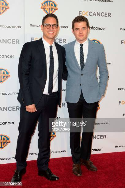 Writer and producer Greg Berlanti and soccer player Robbie Rogers arrive for the F*ck Cancer Gala at Warner Bros Studio in Burbank California on...