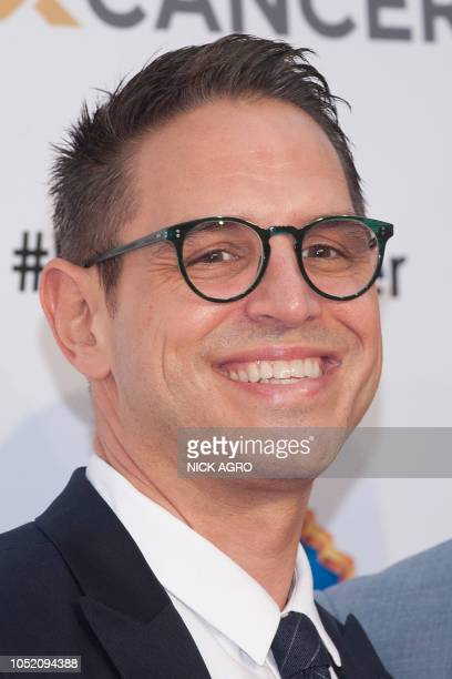 Writer and producer Greg Berlanti arrives for the F*ck Cancer Gala at Warner Bros Studio in Burbank California on October 13 2018