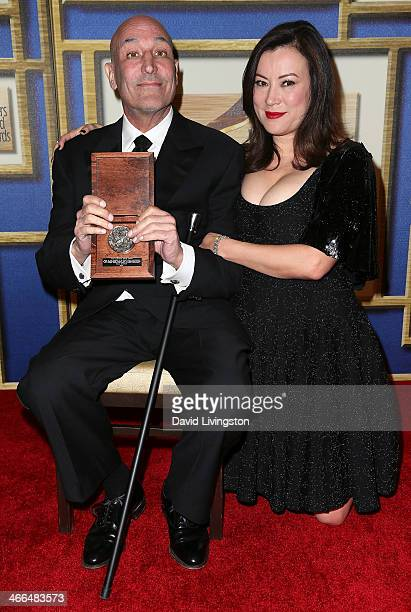 Writer and Valentine Davies Award honoree Sam Simon and actress Jennifer Tilly attend the press room at the 2014 Writers Guild Awards LA Ceremony at...
