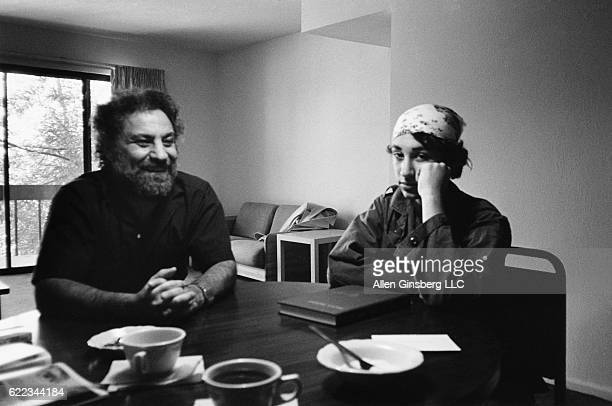 Writer and Youth International Party member Abbie Hoffman sits with his son America at their breakfast table in Boulder Colorado