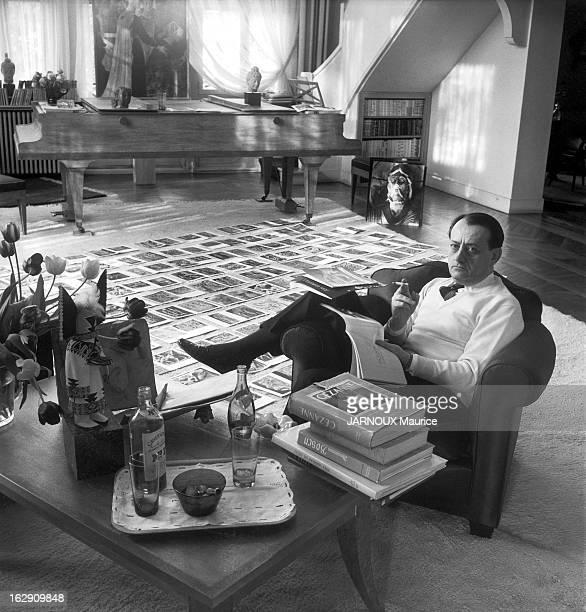 writer Andre Malraux poses in his house of Boulogne near Paris working at his book Le Musee Imaginaire or Imaginary Museum 2nd volume Du bas relief...