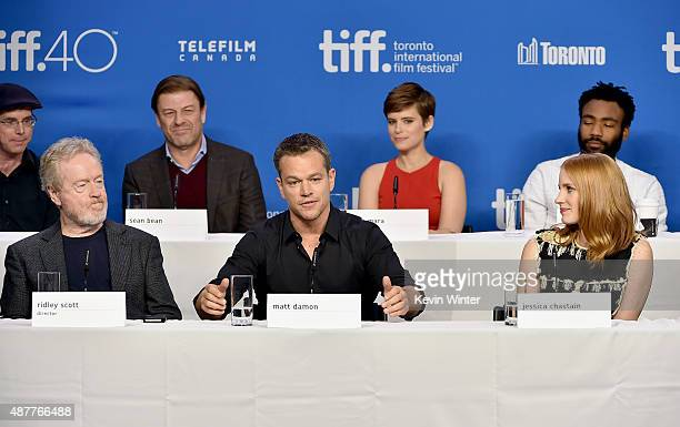 Writer Andy Weir director Ridley Scott actors Sean Bean Matt Damon Kate Mara Jessica Chastain and Donald Glover speak onstage during the 'The...