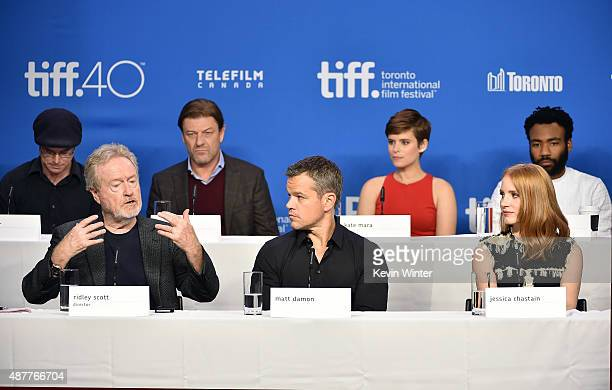 Writer Andy Weir director Ridley Scott actors Sean Bean Matt Damon Kate Mara Jessica Chastain and Donald Glover speak onstage during the 'The...
